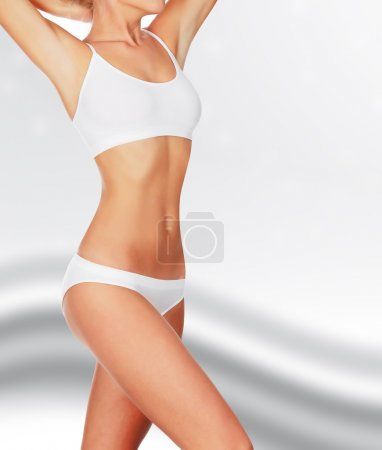 Slim woman against abstract background
