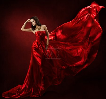 Woman in red waving dress dancing with flying fabric