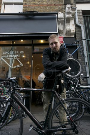 man standing outside bicycle shop