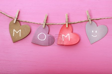 Mothers day message on paper hearts