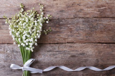 Beautiful floral frame with lilies of the valley
