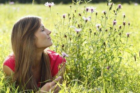 Attractive woman enjoys summer outdoor