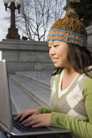 Girl Working On Computer Outside