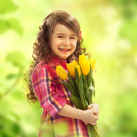 Smiling girl with big bouquet of flowers