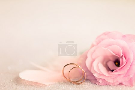 Wedding  Background with gold Rings, gentle flower and light pin