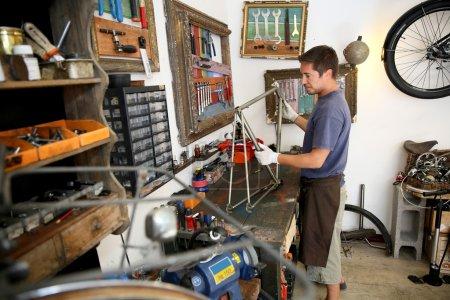 Man fixing bike frame