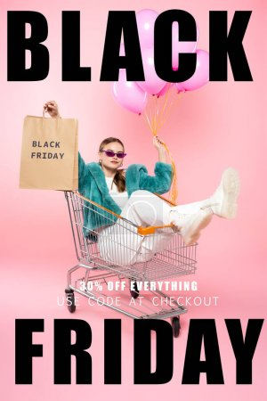 stylish woman in sunglasses sitting in cart with shopping bags and holding balloons near black friday lettering and tag on pink
