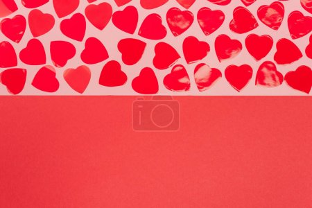 top view of hearts on red and pink background