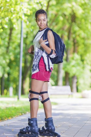 Sport Concepts. Young African American Teenage Girl Posing on Roller Skates