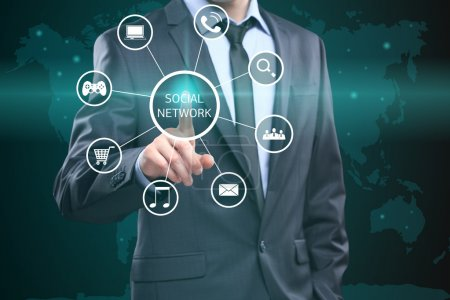 business, technology, internet and networking concept - businessman pressing button with Social Network on virtual screens.