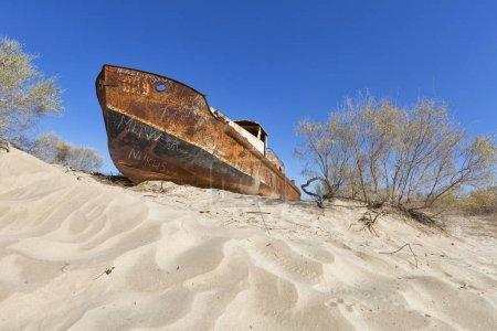 Rustic boat on a ship graveyard on a desert around Moynaq, Aral sea, Uzbekistan