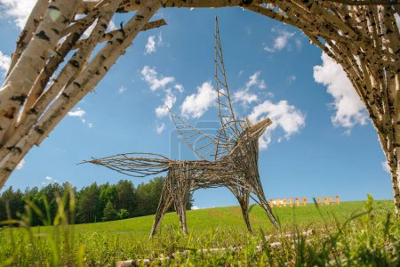 Land art horse with wings. Sculpture of branches