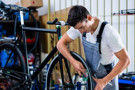 Mechanic repairing bicycle