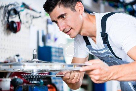 mechanic working in his bike workshop
