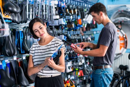 Woman buying parts in shop
