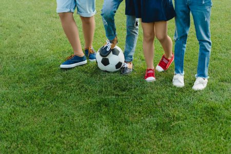 Children standing with soccer ball