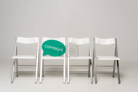 row of chairs and thought bubble with copyright inscription on grey background