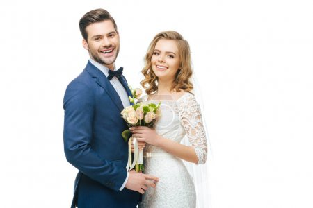 portrait of smiling bride with wedding bouquet and groom isolated on white