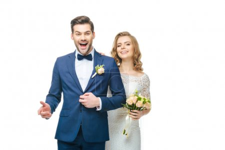 portrait of happy young wedding couple isolated on white