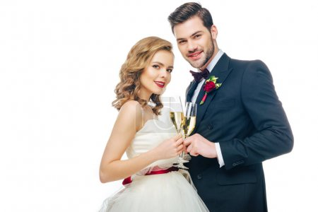 portrait of beautiful wedding couple with glasses of champagne isolated on white