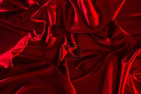 red shiny silk fabric background
