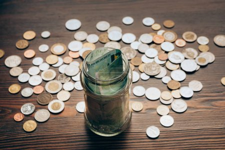 glass jar with banknotes
