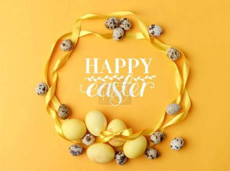 top view of yellow painted easter eggs and quail eggs on yellow with happy easter lettering
