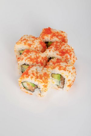 delicious California roll with avocado, salmon and masago caviar on white surface