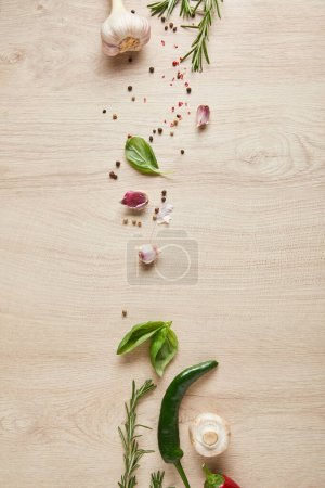 top view of delicious herbs and spices on wooden table