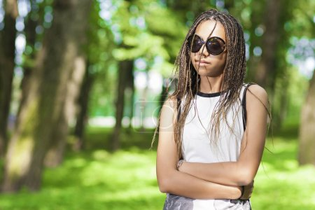 Teens Lifestyle Concepts and Ideas. Positive African American Teenage Girl With Long Dreadlocks