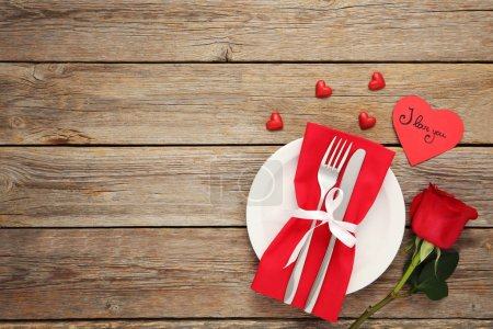 Fork and knife with red rose