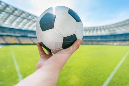 person holding soccer ball