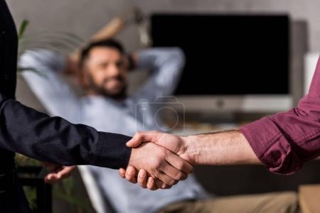 cropped image of businessmen shaking hands