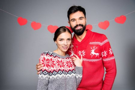Smiling couple in knitted sweaters