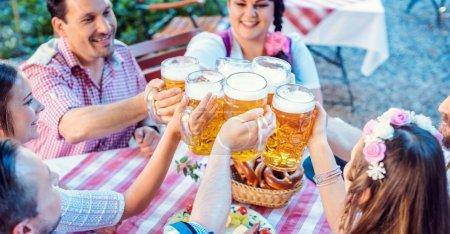 People enjoying food and drink in Bavarian beer garden