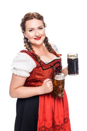 happy oktoberfest waitress in traditional bavarian dress holding mugs with light and dark beer isolated on white background