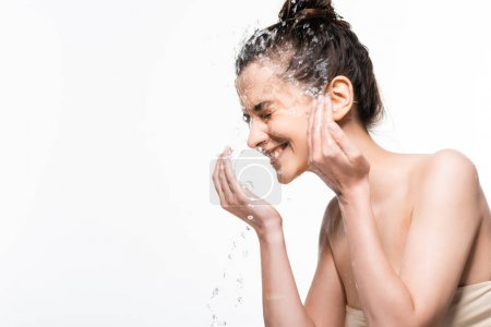 happy young brunette woman with natural beauty washing up with clean water splash isolated on white