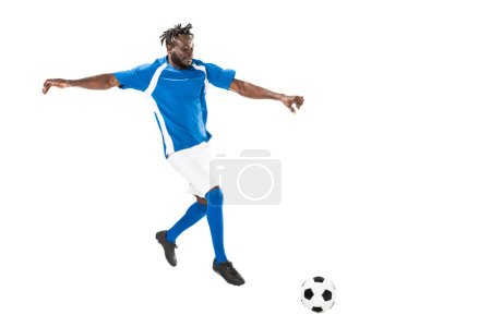 full length view of athletic african american soccer player hitting ball isolated on white