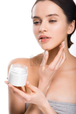 pretty woman holding container with cosmetic cream isolated on white