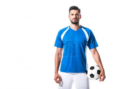 soccer player holding ball and looking at camera Isolated On White