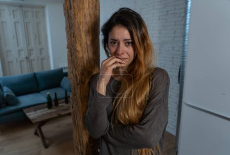 Social issues Domestic violence concept. Woman victim of spouse intimate abuse and physical aggression feeling hopeless and scared crying in distress powerless to stop violence.