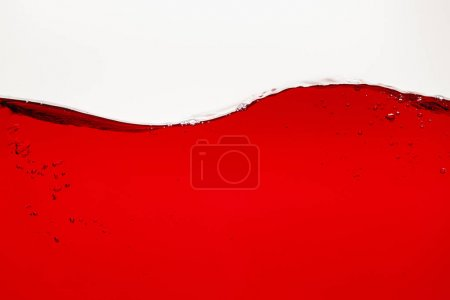 wavy red bright liquid with bubbles isolated on white