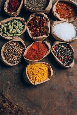 top view of indian spices in paper bags on table