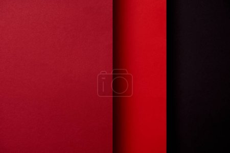 Abstract background with paper sheets in red tones