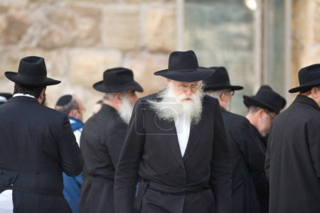 JERUSALEM, ISRAEL - Feb 18, 2013: Bar Mitzvah ritual at the Wailing wall in Jerusalem. A 13 years old boy who has become Bar Mitzvah is morally and ethically responsible for his decisions and actions