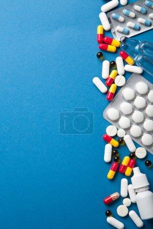 Pills border over blue