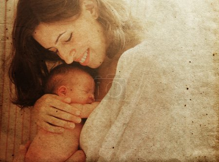 Mother with her baby.Photo in old image style.