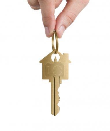 Human hand holding gold key